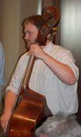 Travis Stimeling playing bass.